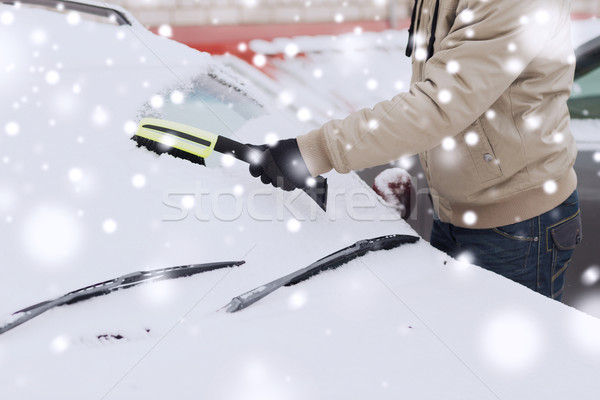 closeup of man cleaning snow from car Stock photo © dolgachov