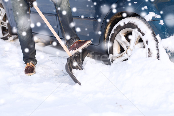 closeup of man digging snow with shovel near car Stock photo © dolgachov