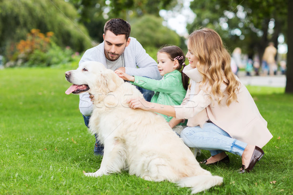 happy family with labrador retriever dog in park Stock photo © dolgachov