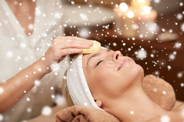 close up of woman having face cleaning in spa Stock photo © dolgachov
