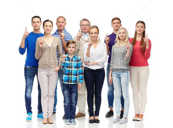group of people pointing finger up Stock photo © dolgachov