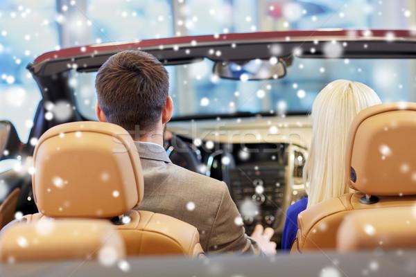couple sitting in cabrio car at auto show Stock photo © dolgachov