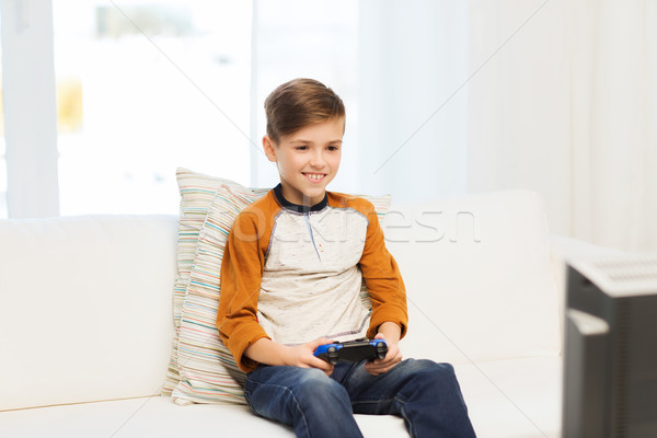 Joystick jouer jeu vidéo maison loisirs Photo stock © dolgachov