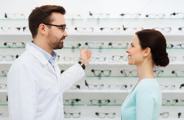 Nő optikus mutat szemüveg optika bolt Stock fotó © dolgachov