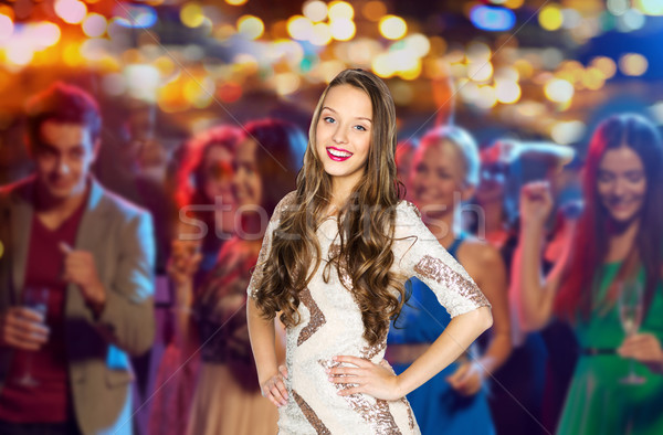 happy young woman or teen girl at disco club Stock photo © dolgachov