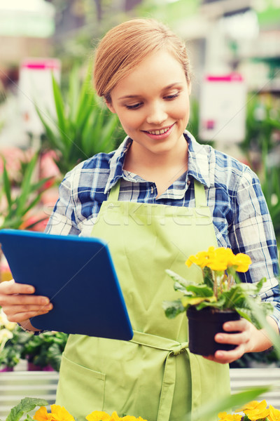happy woman with tablet pc in greenhouse Stock photo © dolgachov