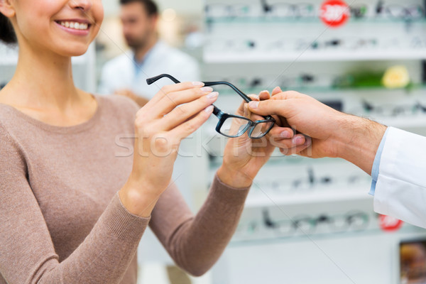 close up of woman with glasses at optics store Stock photo © dolgachov