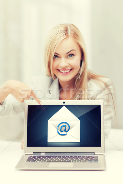 woman with laptop pointing at email sign Stock photo © dolgachov