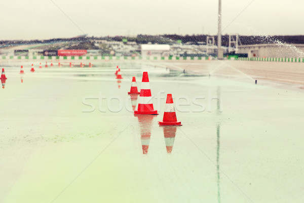 traffic cones and sprinklers on wet speedway Stock photo © dolgachov