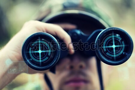 close up of soldier or sniper with gun in forest Stock photo © dolgachov
