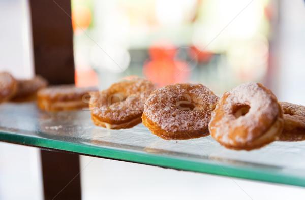 close up of sugared donuts on showcase shelf Stock photo © dolgachov