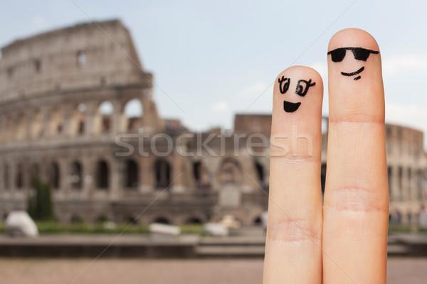 два пальцы лицах семьи Сток-фото © dolgachov
