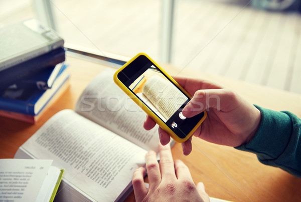 student hands with smartphone making cheat sheet Stock photo © dolgachov