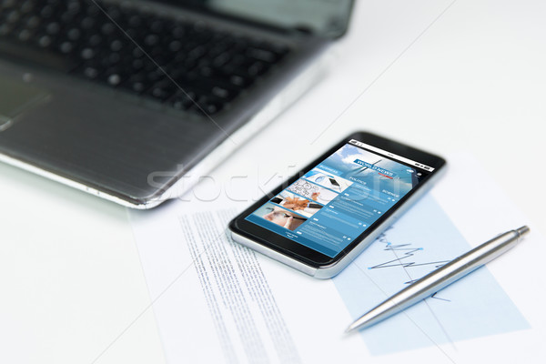 Stock photo: close up of smartphone with business news page