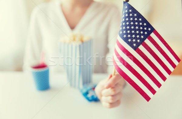 Stock photo: close up of woman holding american flag
