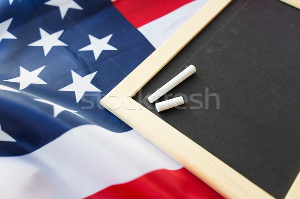 close up of school blackboard on american flag Stock photo © dolgachov