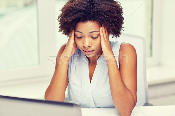 african woman with laptop at office Stock photo © dolgachov