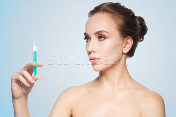 Bela mulher seringa injeção saúde pessoas Foto stock © dolgachov