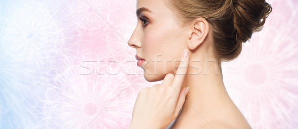 beautiful woman pointing finger to her ear Stock photo © dolgachov
