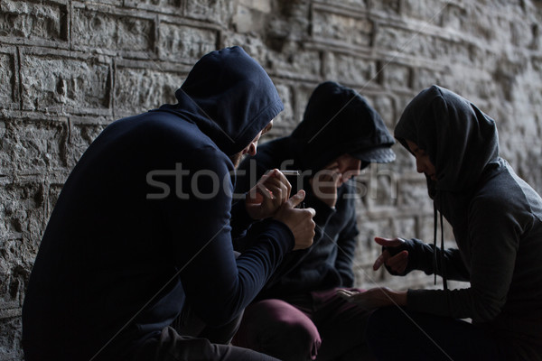 close up of young people smoking cigarettes Stock photo © dolgachov