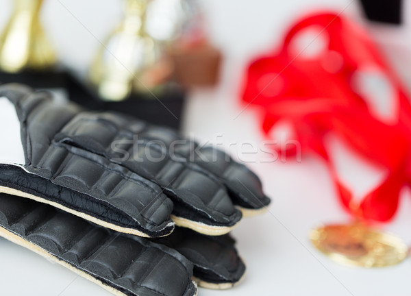 close up of football, gloves, cups and medals Stock photo © dolgachov