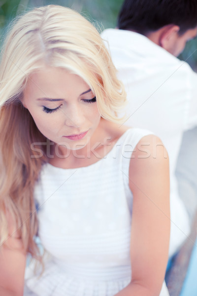 stressed woman with man outside Stock photo © dolgachov