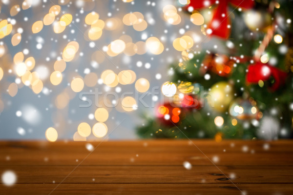 empty wooden surface over christmas tree lights Stock photo © dolgachov