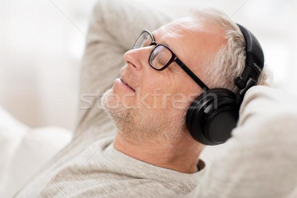 счастливым человека наушники домой технологий Сток-фото © dolgachov