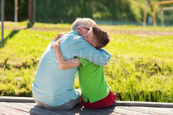 grandfather and grandson hugging on berth Stock photo © dolgachov
