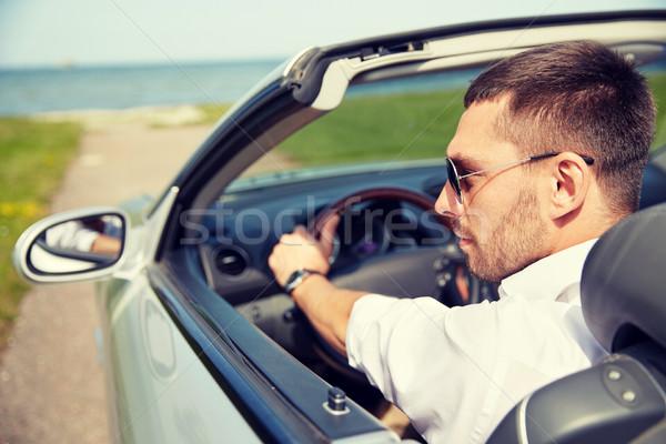 Feliz hombre conducción cabriolé coche aire libre Foto stock © dolgachov