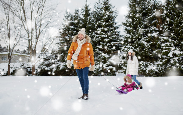 happy family with sled walking in winter outdoors Stock photo © dolgachov