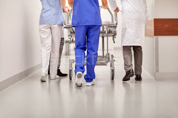 medics carrying hospital gurney to emergency room Stock photo © dolgachov