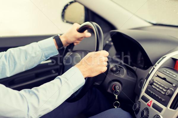 Genç sürücü araba taşıma iş gezisi Stok fotoğraf © dolgachov