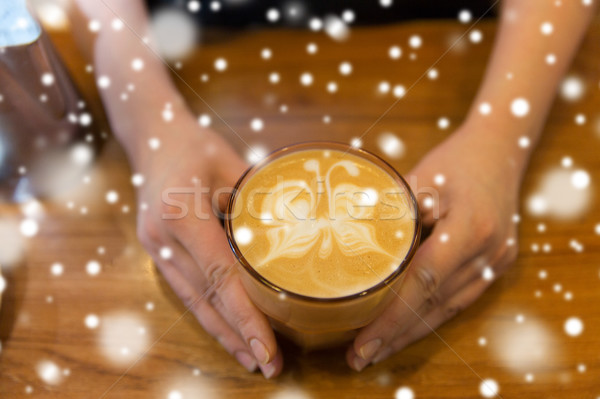 close up of hands with latte art in coffee cup Stock photo © dolgachov