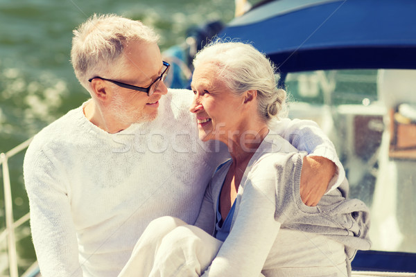 senior couple hugging on sail boat or yacht in sea Stock photo © dolgachov