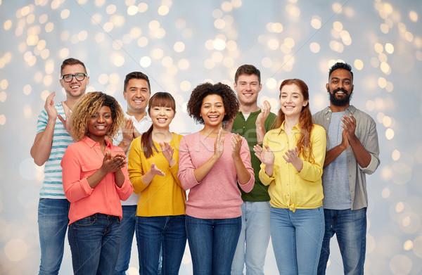international group of happy people applauding Stock photo © dolgachov