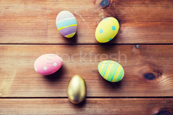 Közelkép színes húsvéti tojások húsvét ünnepek hagyomány Stock fotó © dolgachov