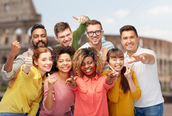 international people showing thumbs up at coliseum Stock photo © dolgachov