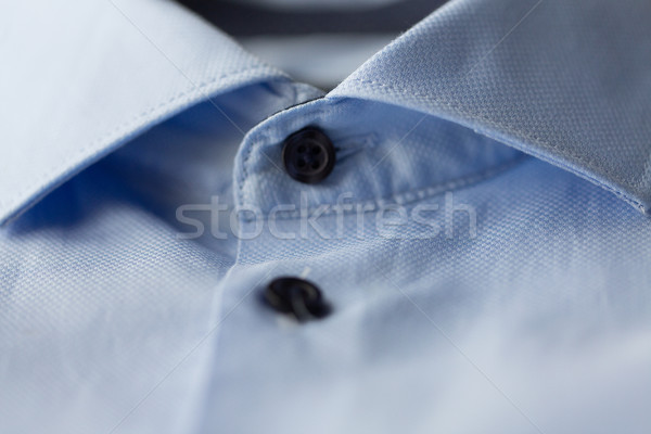close up of blue shirt collar Stock photo © dolgachov