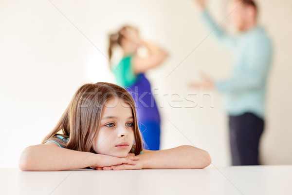 beautiful sad girl and parents arguing at home Stock photo © dolgachov