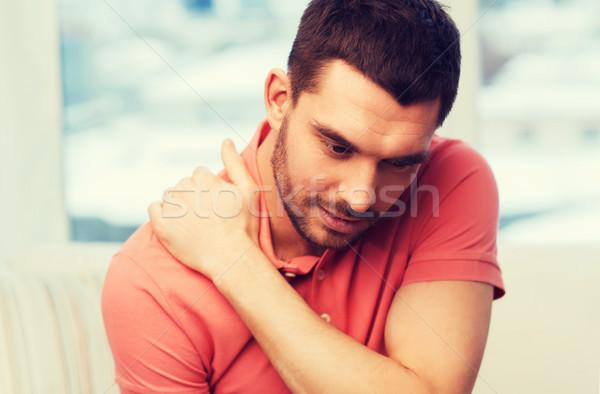 Mutsuz adam boyun ağrısı ev insanlar Stok fotoğraf © dolgachov