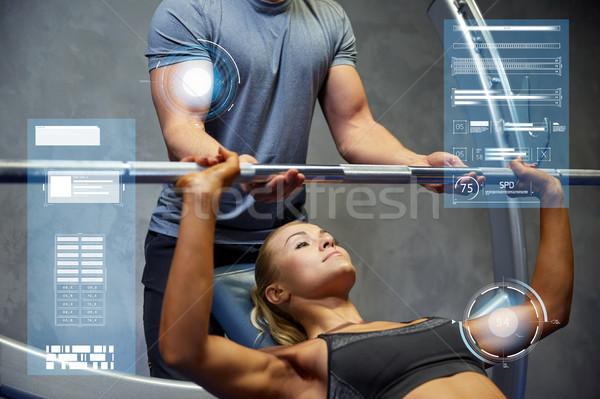 Człowiek kobieta sztanga mięśni siłowni sportu Zdjęcia stock © dolgachov
