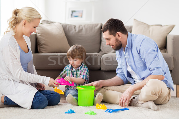 happy family playing with beach toys at home Stock photo © dolgachov