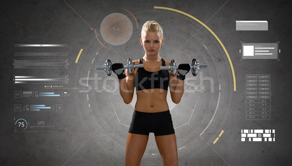 happy young sporty woman exercising with dumbbells Stock photo © dolgachov
