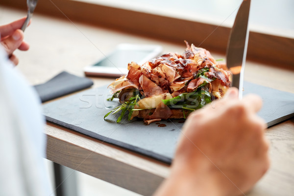 woman eating prosciutto ham salad at restaurant Stock photo © dolgachov