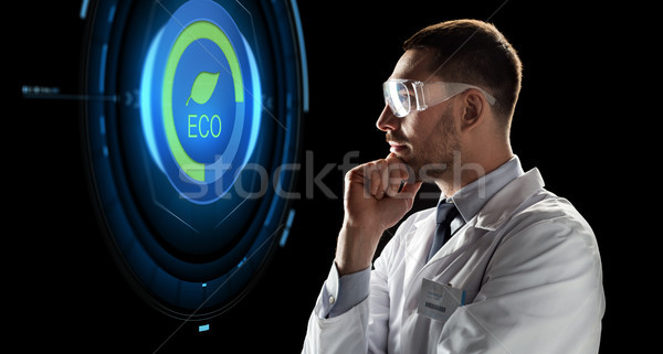 scientist in goggles looking at virtual projection Stock photo © dolgachov