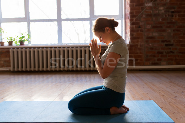 close up of woman meditating at yoga studio Stock photo © dolgachov