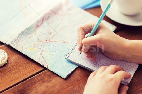 close up of traveler hands with notepad and pencil Stock photo © dolgachov