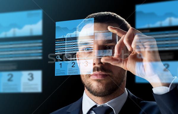 Empresario intercambio gráficos negocios realidad Foto stock © dolgachov