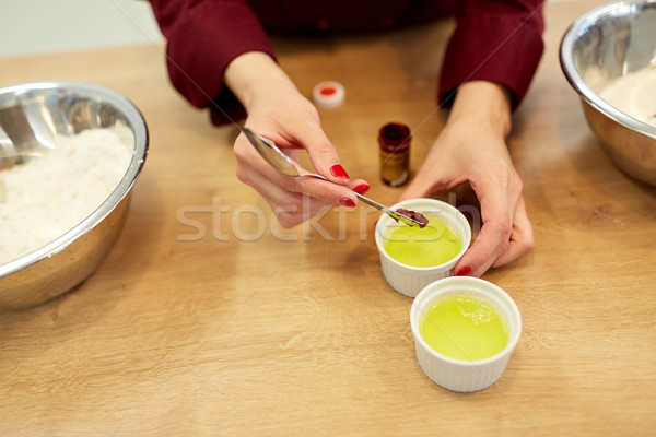 chef adding food color into bowl with egg whites Stock photo © dolgachov